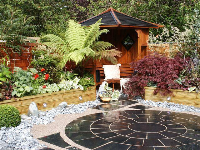 Black Limestone Circle. Private Garden by Alan Rowan Landscape Gardener