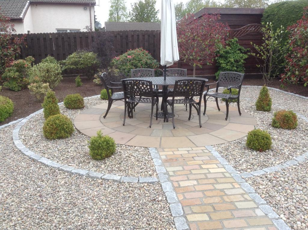 Beige Sandstone Circle, with Cathedral Setts, Rustic and Cropped Setts, Silver Grey. Private Garden by Alan Rowan Landscape Gardener