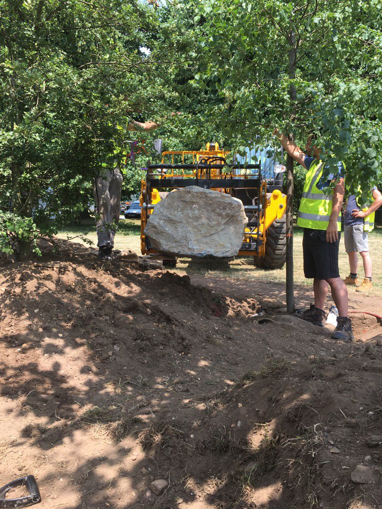 The boulders being moved into place…