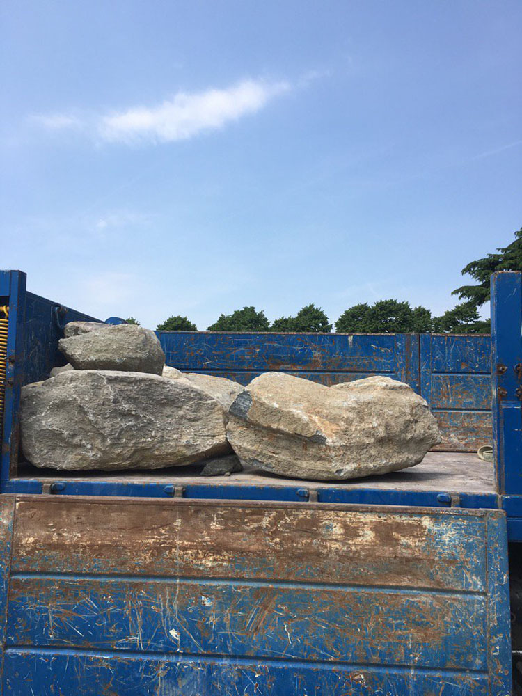 The boulders being delivered to Hampton Court