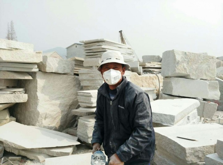 An employee keeping safe with a protective mask…