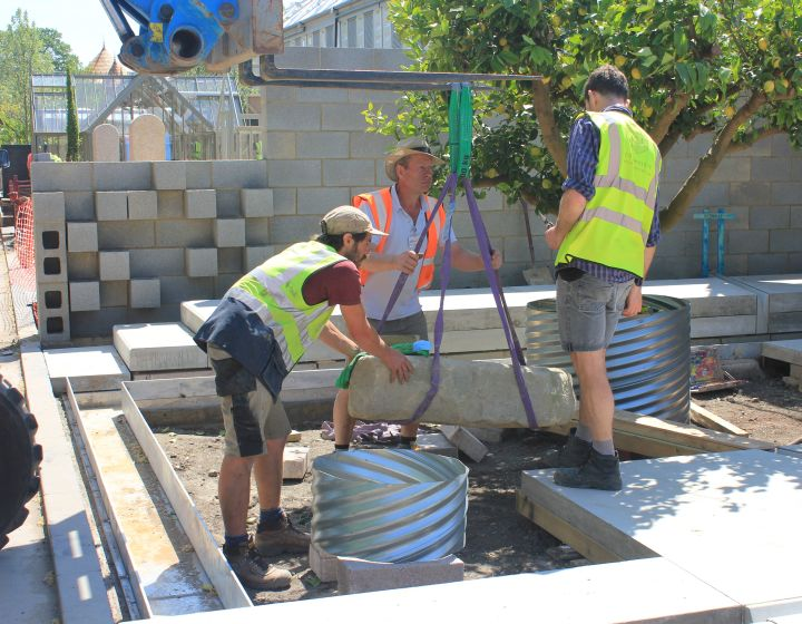 Tom and the team from Landscape Associates placing a Yorkstone rockery…