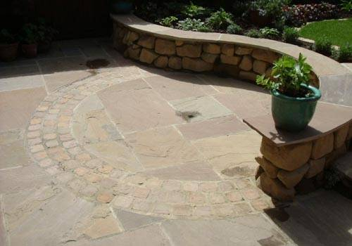 Beige Riven Sandstone Paving laid in Private Garden' designed by Lizzie Taylor