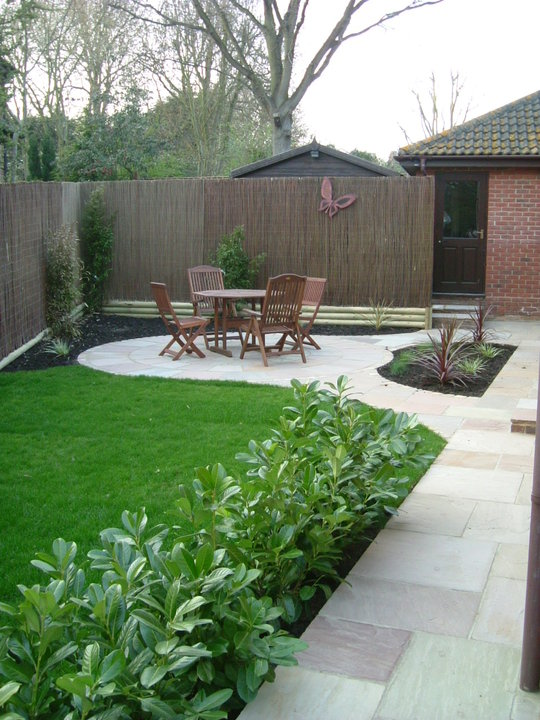 Beige Riven Sandstone Paving and Circle. Private Garden' designed and built by John Charles Landscapes.