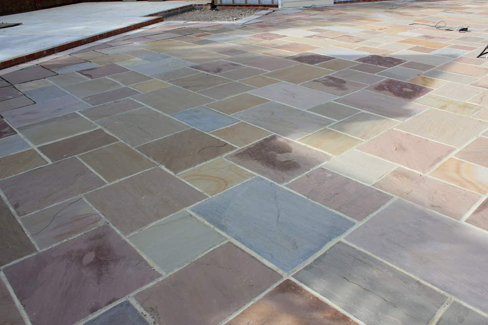 Beige riven sandstone paving' private patio area. Garden designed and built by J. Wenman & Sons. For further images of this job please visit our Projects-Private Places Gallery.