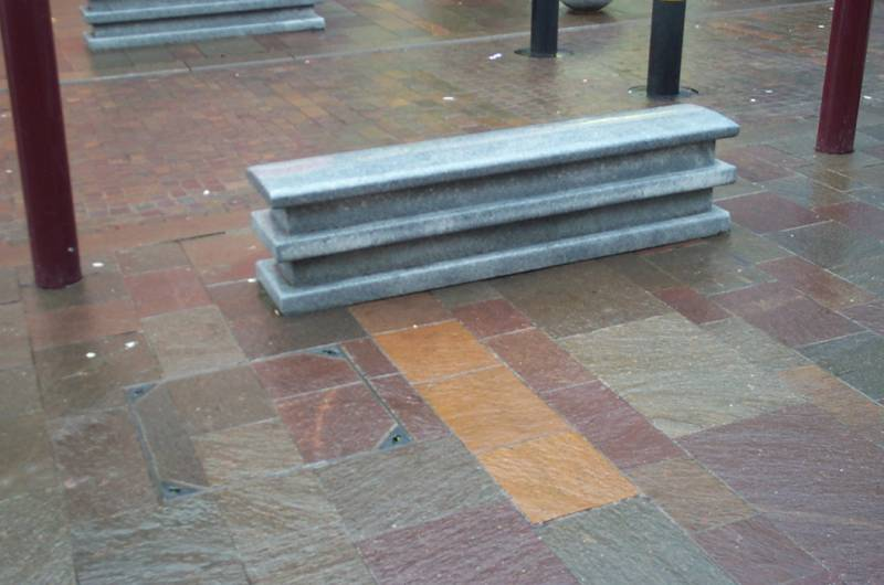 Silver Grey Granite Bench with porphyry paving' Hamilton. Contractor - Phase 1: Land Engineering Phase 2: O'Brien Properties Ltd. Designer - David Blakemore Associates. For further details of this job please go to our Projects Gallery.