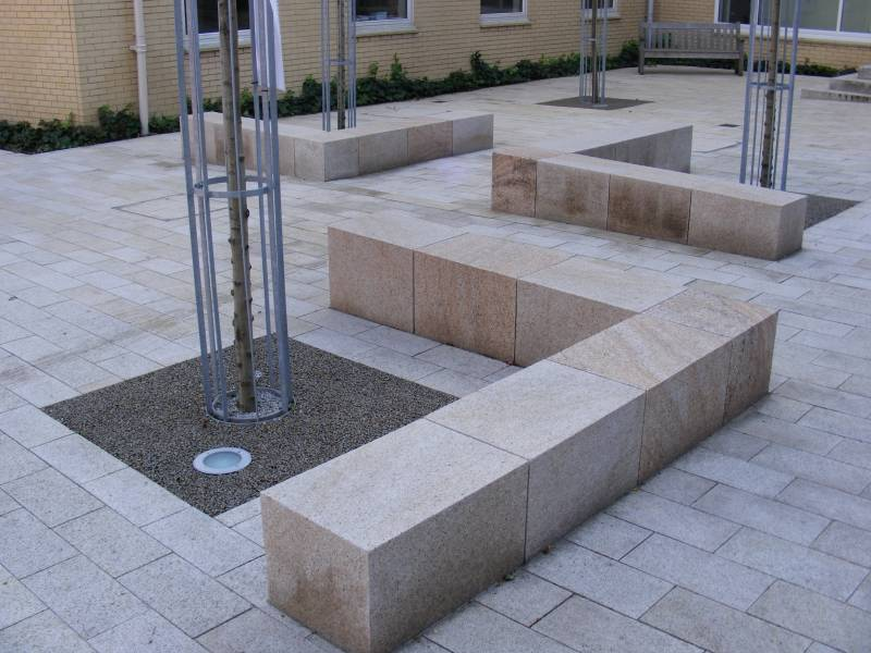 Beige granite benches at Alleyn's School' London. Contractor - Rooff Limited.