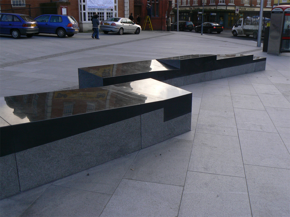 Polished and flamed granite benches' Acton Square. Contractor - Skanska McNicholas. Designer - East Architects. For further details of this job please go to our Projects Gallery.