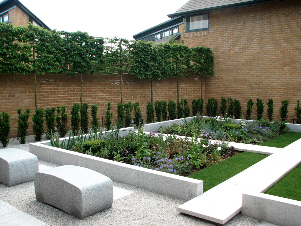 Bespoke honed silver grey granite benches in a private garden designed and built by Harlow Garden Services. For further images of this job please visit our Projects-Private Places gallery.