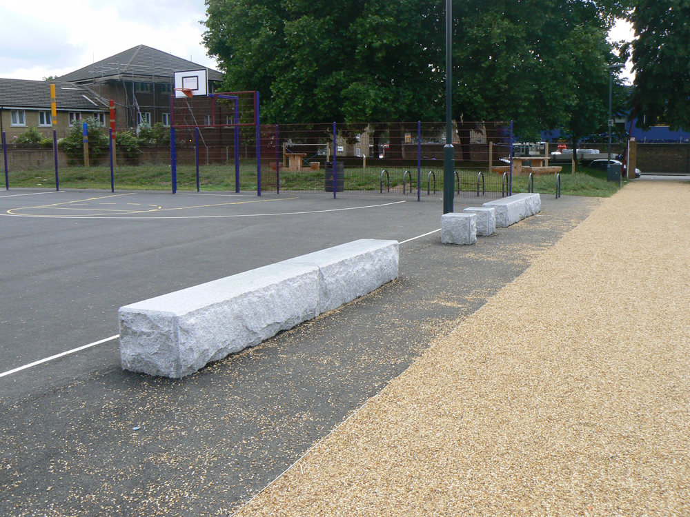 Silver grey granite benches. St George's Square' London.