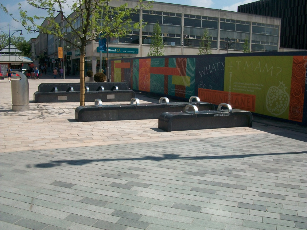 Honed blue limestone benches. The Moor' Sheffield. Contractor - North Midland Construction Ltd. Designer - Broadway Malyan.