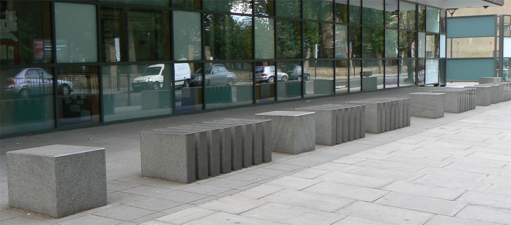 Green granite bollards with polished top surfaces and front edges' and flame textured sides. St Mary Magdalene Academy' London. For further images and info on this job please visit our Projects Gallery.