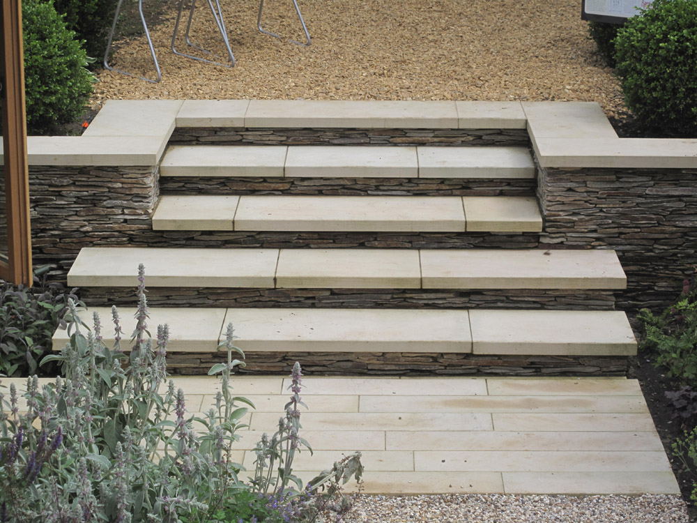 Buff Sandstone Steps and Yellow Quartz Paddlestone Walling at Majestic Trees Nursery' Hertfordshire. For further images of this job please visit our Projects-Private Places Gallery.