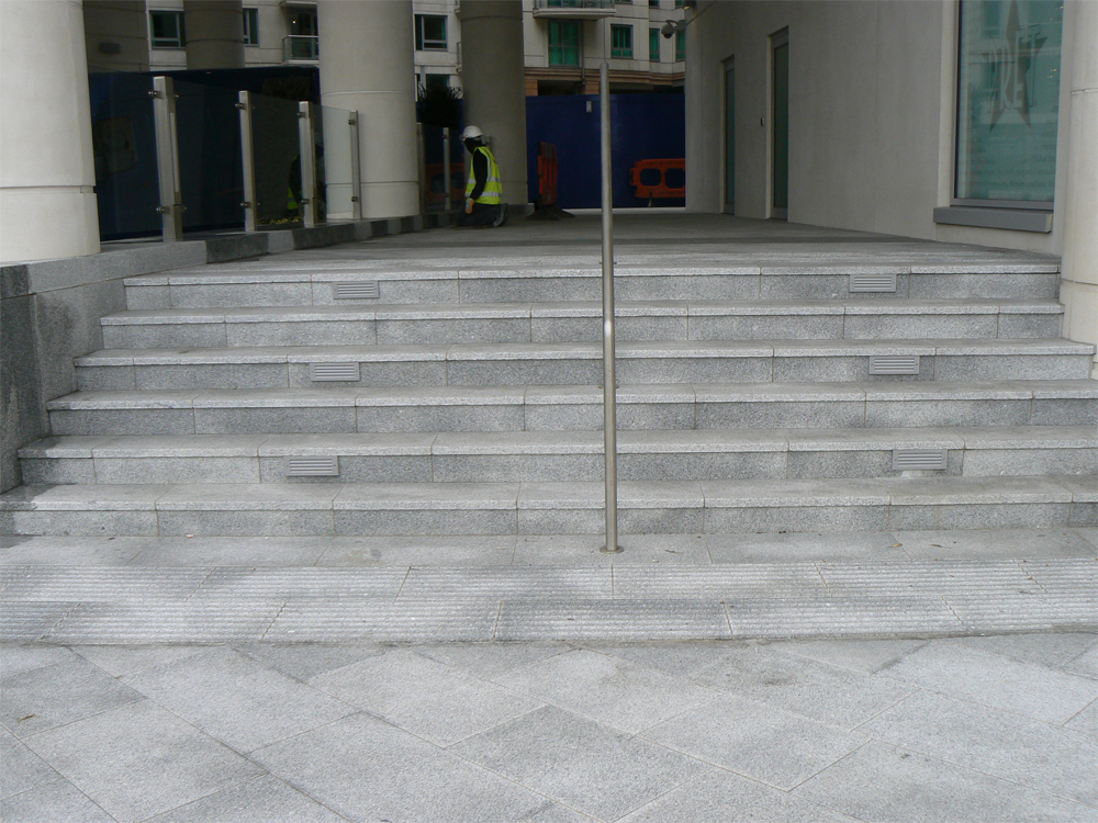 Silver Grey Granite Steps' St George's Wharf. Designer - Broadway Malyan. Contractor - McArdle ECS Ltd.
