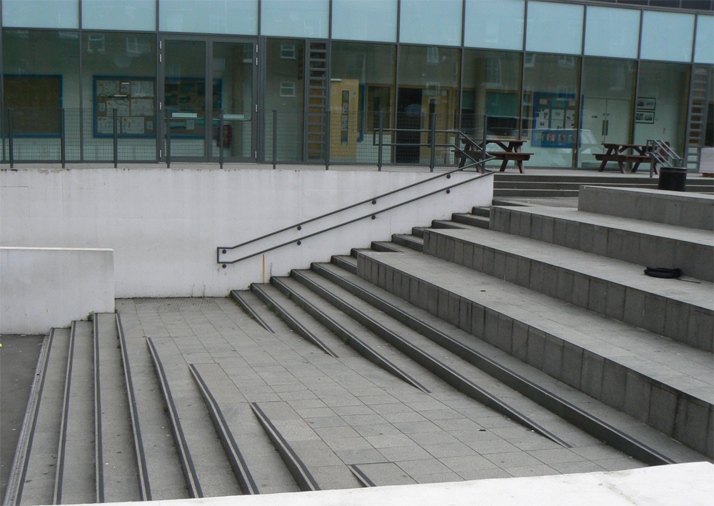 Green granite steps at St Mary Magdalene Academy' London. For further images and info on this job please visit our Projects Gallery.