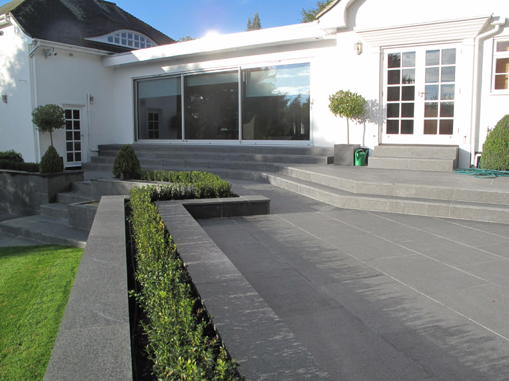 Black basalt paving' steps and wall coping. Private garden designed and built by Alan Carvosso. For further images of this job please visit our Projects-Private Places Gallery.