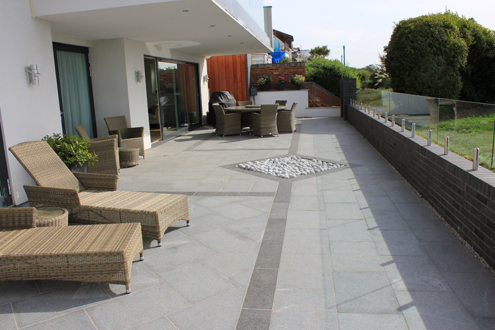Black Basalt paving detail with blue grey granite paving and silver grey granite cobbles. Private patio designed and built by Alan Carvosso. For further images of this job please visit our Projects-Private Places Gallery.