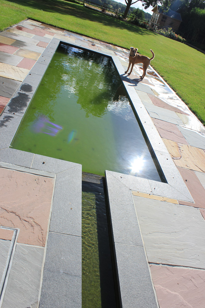 Black basalt plank paving with a mix of green' grey and pink riven sandstone paving. Private garden designed and built by Baylis Landscapes. For further images of this job please visit our Projects-Private Places Gallery.