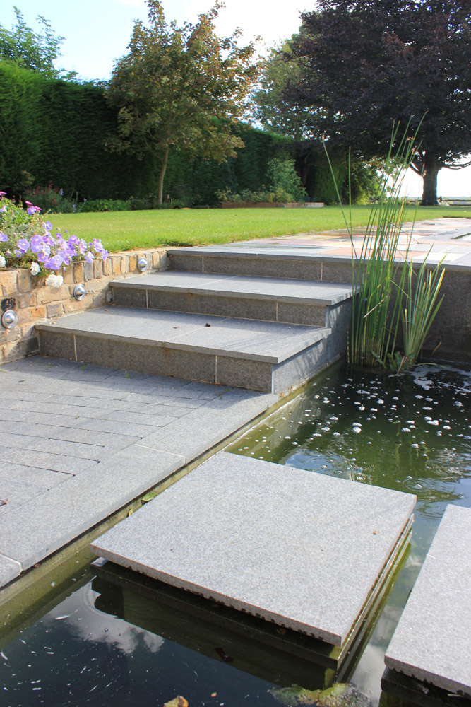 Black basalt plank paving. Private garden designed and built by Baylis Landscapes. For further images of this job please visit our Projects-Private Places Gallery.