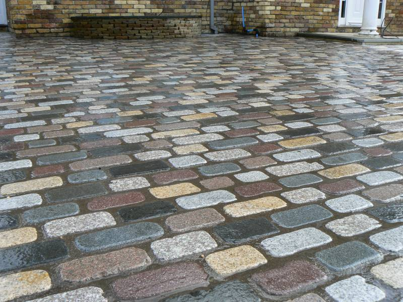 Temple Setts - mix of all seven colours (pictured here when wet). Private driveway designed and built by Regent Driveways.