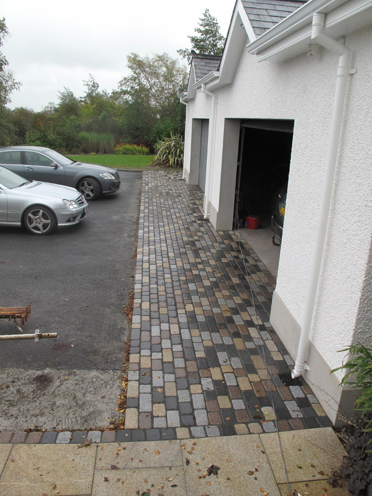 Temple setts - all colours except red (pictured here when wet). Private driveway in Ireland designed by Beth Moore and built by Ben McKee Landscapes. For further images of this job please visit our Projects Gallery.