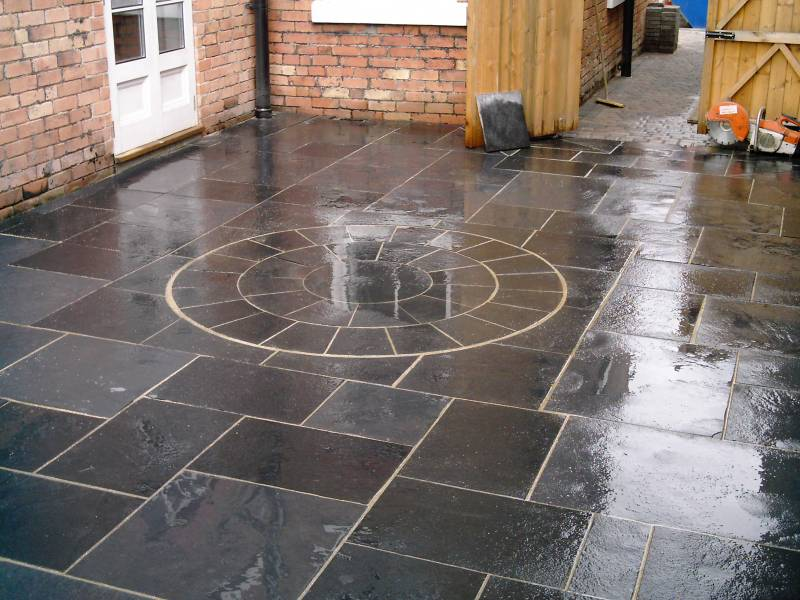 black limestone riven paving
