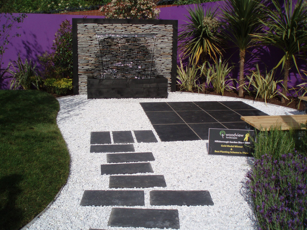 Meadowgrass Marble with black riven limestone paving and black quartz paddlestones. Gold medal winner at The Hillsborough Flower Show 2008' designed by Woodview Landscapes. For further images of this garden please visit our Projects-Private Places Gallery.