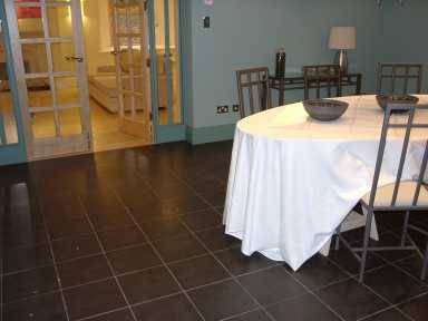 Internal use of Black Slate Riven Paving in Dining Area' Private House.