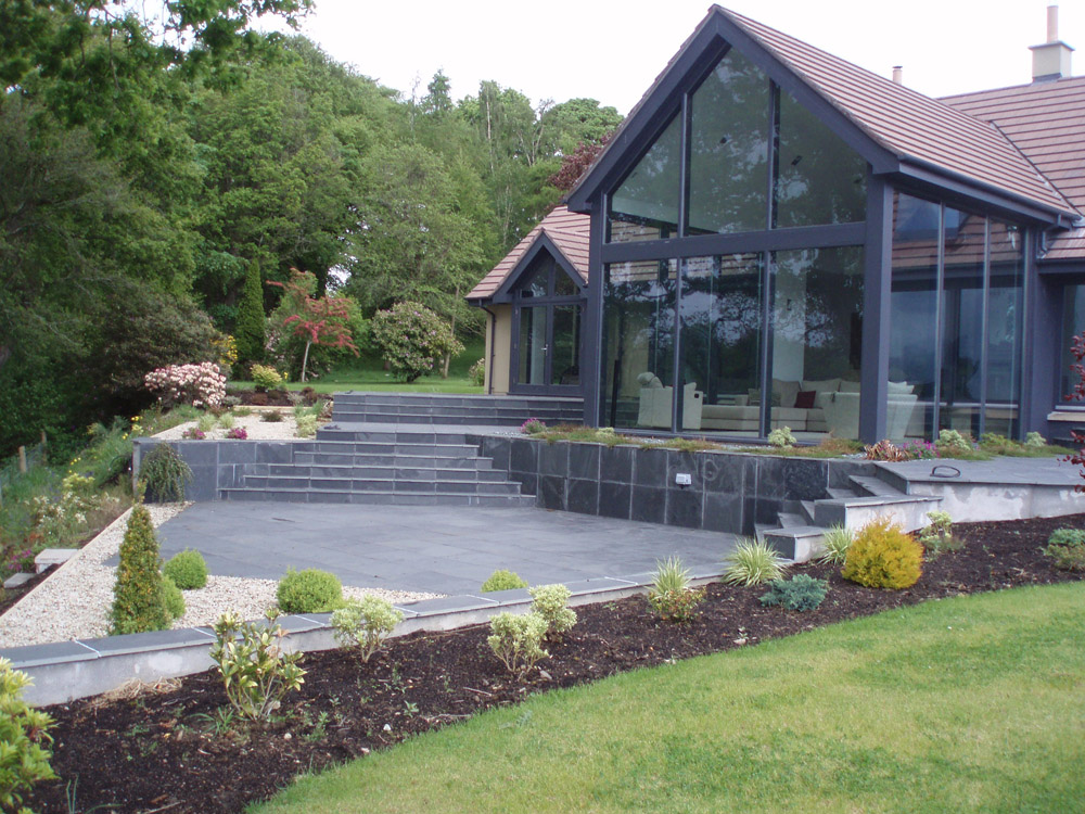 Black riven slate paving. Private garden' in Ireland' designed by Kenny Crawford and built by Cloone Landscapes. For further images of this job please visit our Projects-Private Places Gallery.