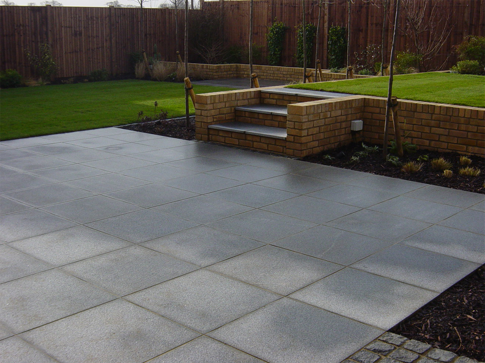 Blue Grey Granite Paving. Private Garden' designed and built by New Eden Landscapes.
