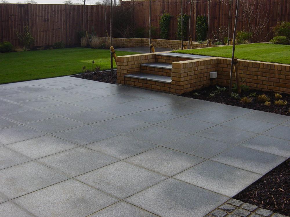Blue Grey Granite Paving. Private Garden' designed and built by New Eden Landscapes.