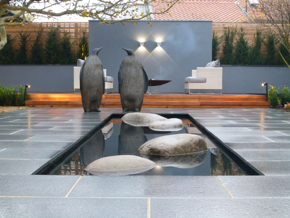 Blue Grey Granite paving and mixed glacial boulders. Private garden designed by Deakinlock Garden Design.