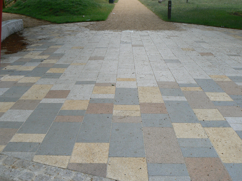 Blue grey granite paving with silver grey' yellow and pink granites. St George's Square' London. For further images and info on this job please visit our Project Gallery.