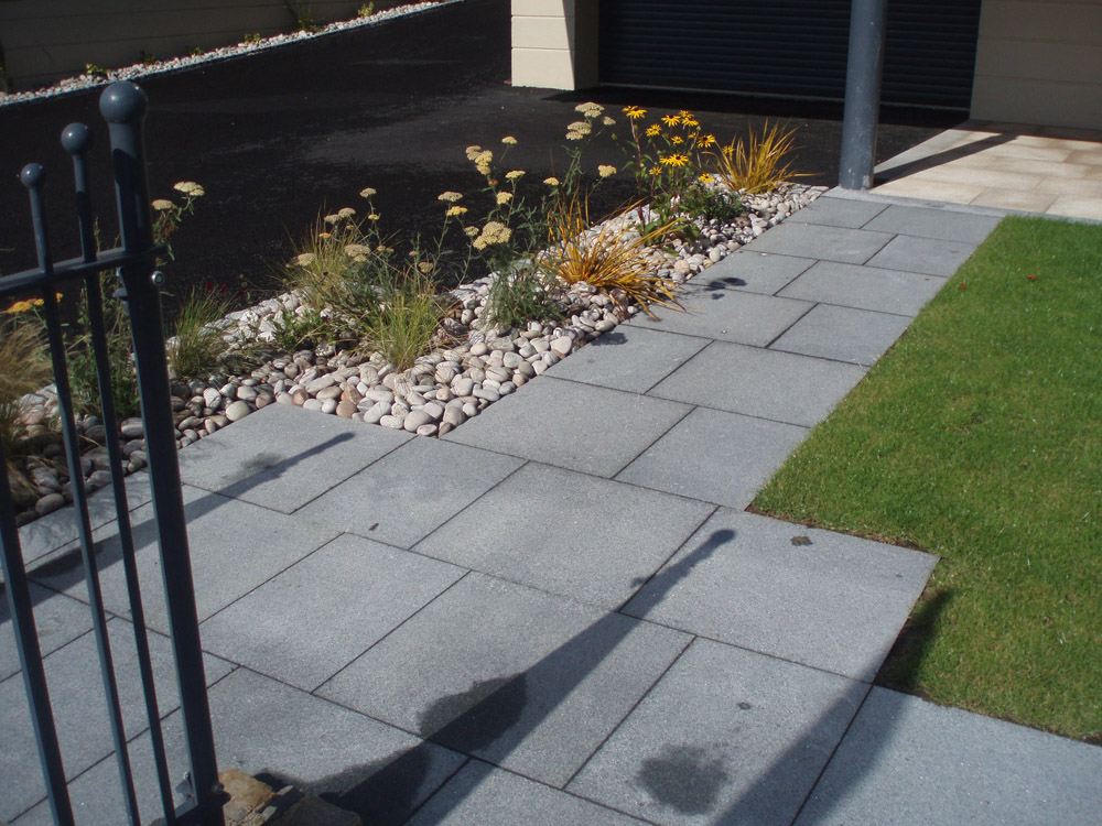 Blue grey granite with Scottish beach pebbles. Private garden' in Ireland' designed by Maurice Maxwell Garden Designs and built by Spring Landscapes. For further images of this job please visit our Projects Gallery.