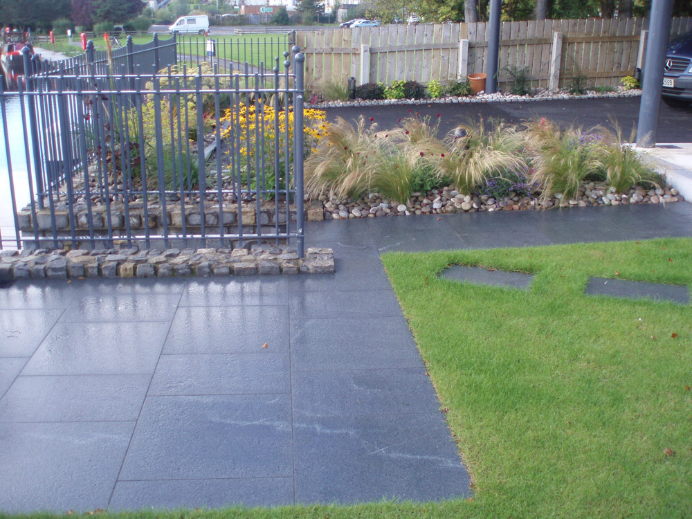 Blue grey granite with Scottish beach pebbles (pictured here when wet). Private garden' in Ireland' designed by Maurice Maxwell Garden Designs and built by Spring Landscapes. For further images of this job please visit our Projects Gallery.