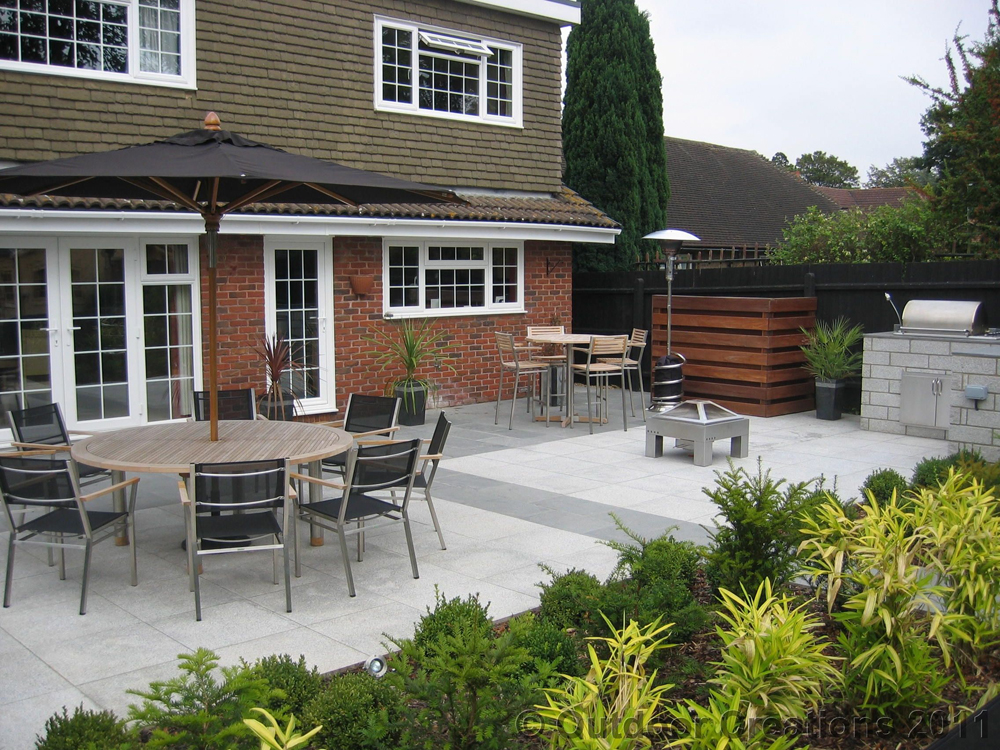 Blue grey granite paving with silver grey granite paving. Private patio designed and built by Outdoor Creations.