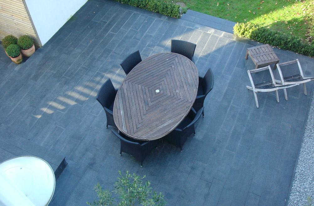 Blue grey granite plank paving' pictured here when wet. Private garden designed and built by the homeowner.