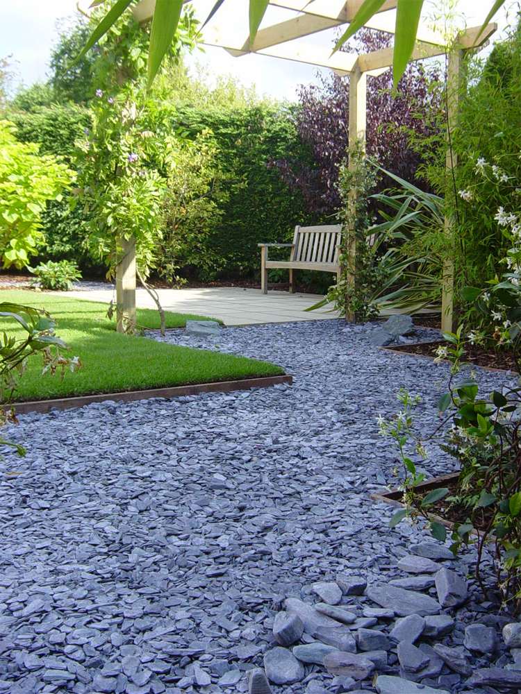 Blue Slate Shale. Private Garden' designed and built by New Eden Landscapes.