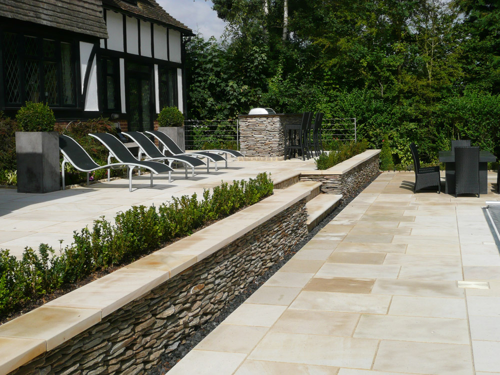 Buff sandstone paving and yellow quartz paddlestones. Private garden designed by John Nash Associates and built by Robert Field Landscapes. For further images of this job please visit our Projects-Private Places gallery