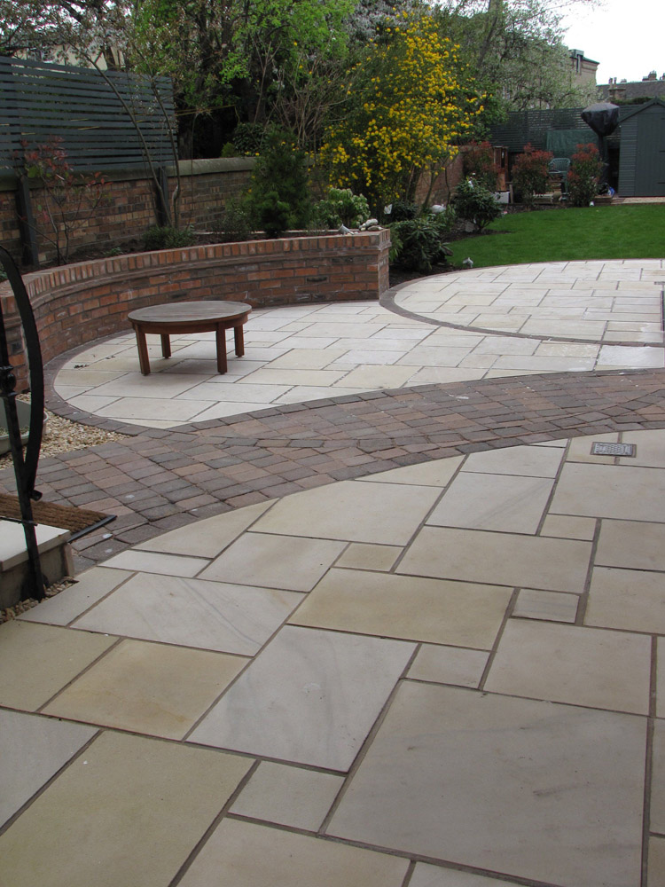 Buff sandstone paving. Private garden in Scotland designed by Green Edge Garden Design and built by Paul Smith Landscaping.