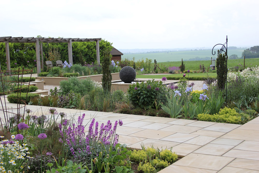 Buff Sandstone Paving in Hitchin' Herts. Private garden designed by Amanda Broughton Garden Design and built by Ramerick Nurseries.