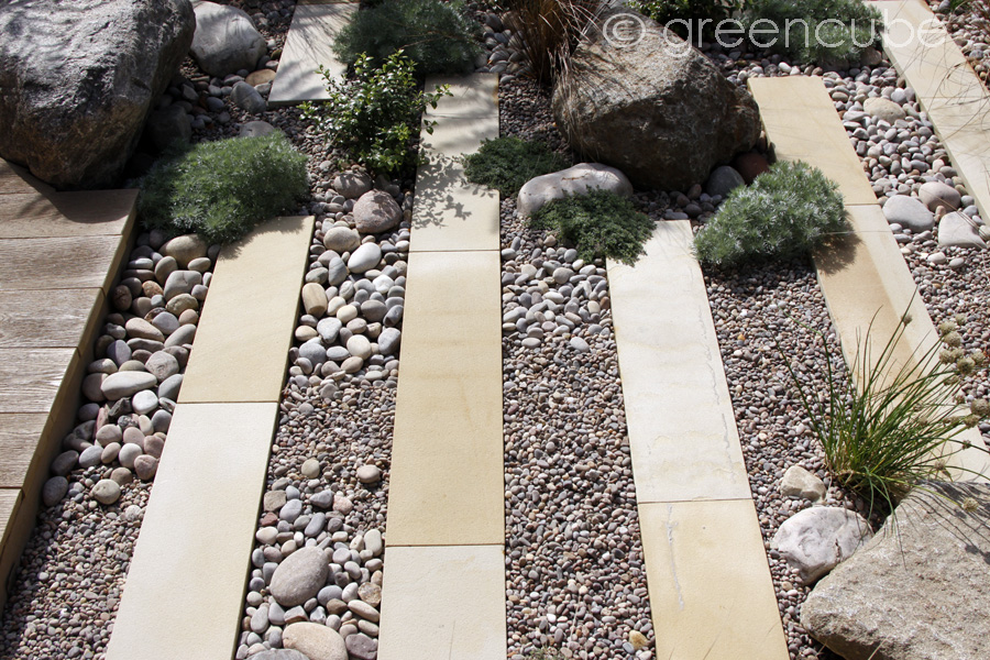 Buff Sandstone Plank Paving with Celtic Boulders and Scottish Beach Pebbles. Garden by Greencube and Quest Landscapes. For further images please visit the Projects-Private Spaces Gallery.
