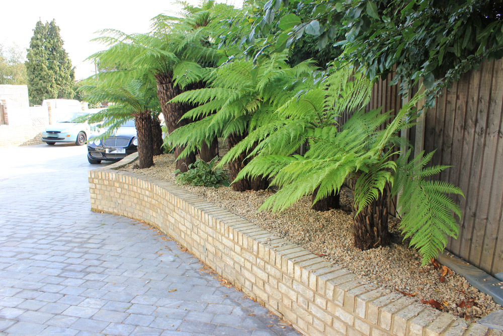 Buff Thames aggregate' private driveway. For further images of this job please visit our Projects-Private Places Gallery. Driveway and gardens designed and built by J. Wenman & Sons.