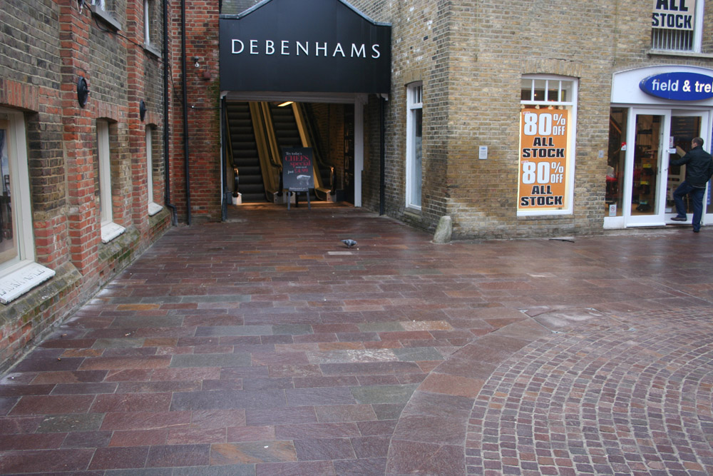 Porphyry setts and paving (pictured here when wet) at Grays Yard' Chelmsford. For further images and info on this job please visit our Projects Gallery.