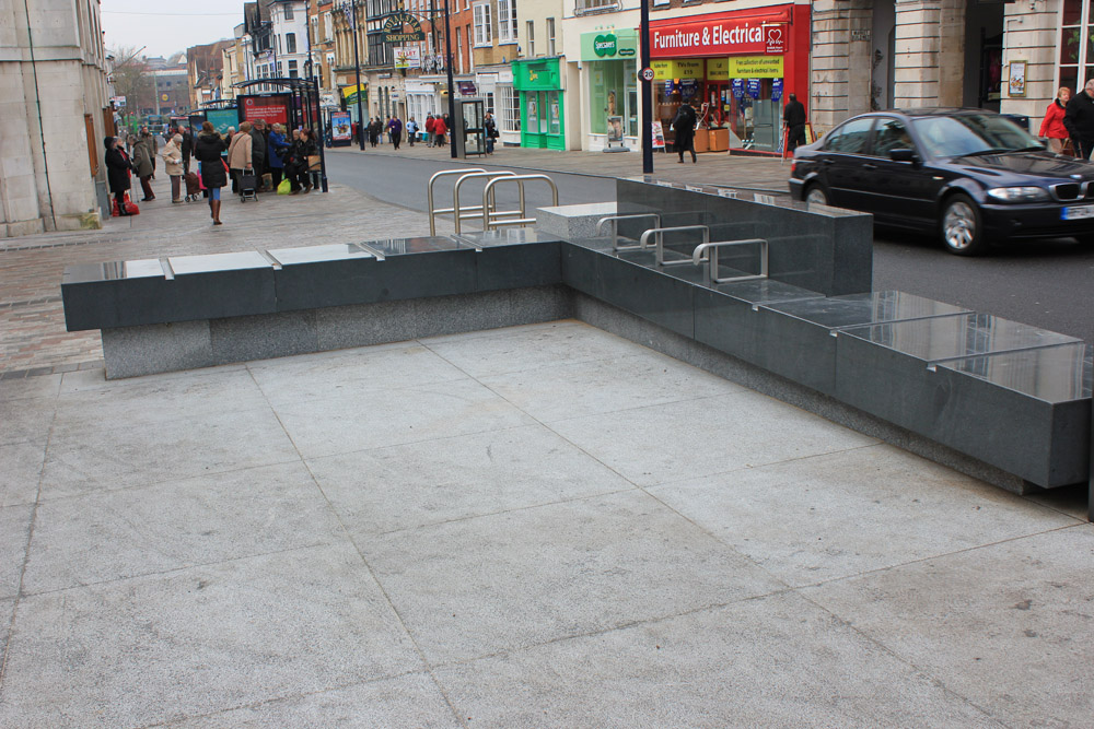 Silver Grey and Blue Grey Granite Bench. Maidstone High Street designed by Letts Wheeler and built by Eurovia. For further images and info on this project please visit our Projects-Public Spaces Gallery.