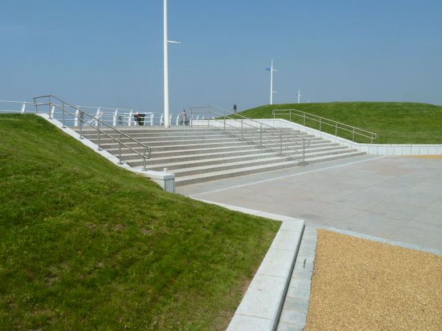 Silver grey granite steps with setts' kerb' walling' coping and pink granite paving at Aberafon Seafront' Wales. For further images and information on this job please visit our Projects-Public Spaces gallery.
