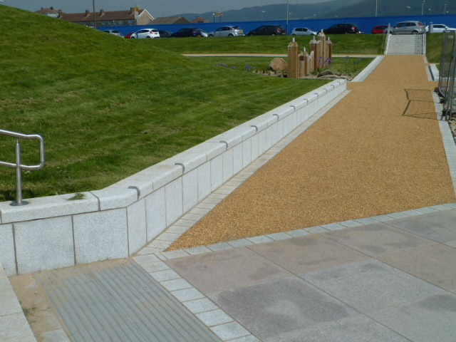Silver grey granite bench/walling with setts and pink granite paving at Aberafon Seafront' Wales. For further images and information on this job please visit our Projects-Public Spaces gallery.