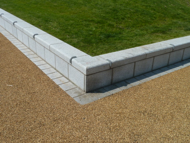 Silver grey granite bench/walling and setts at Aberafon Seafront' Wales. For further images and information on this job please visit our Projects-Public Spaces gallery.