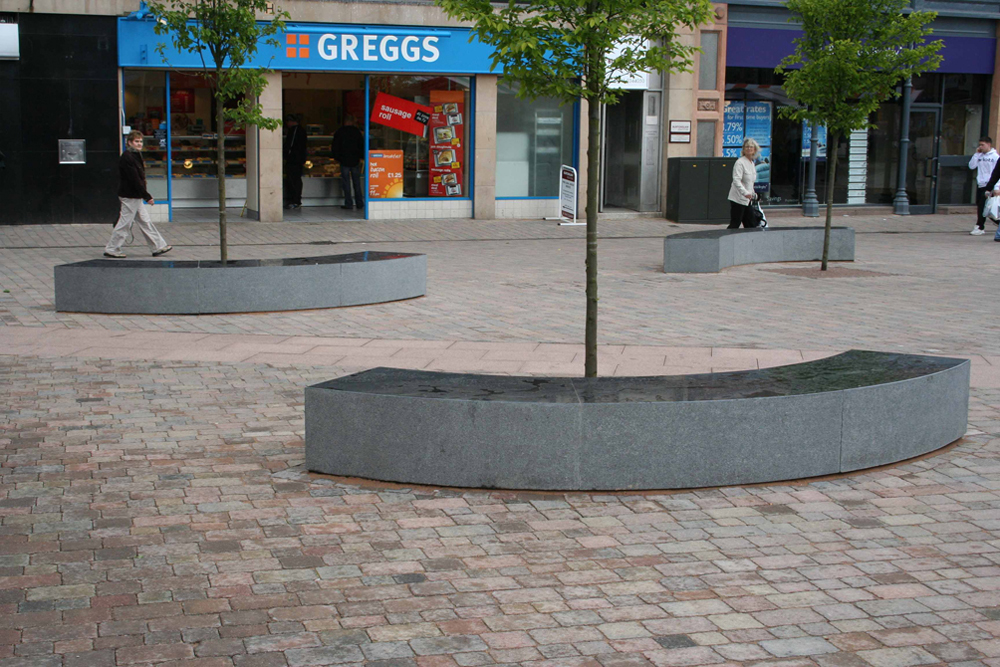 Polished curved benches. Mansfield market place' Nottinghamshire. Contractor - Dave Collis Paving. Designer - Mansfield District Council. For further details of this job please go to our Projects Gallery.