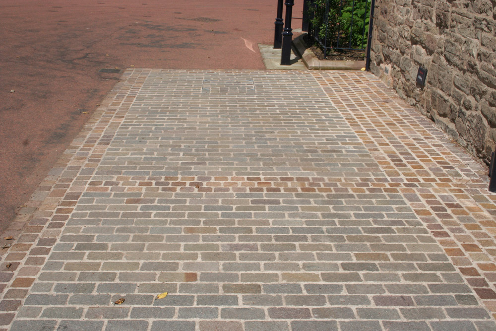 Porphyry setts at Hereford Cathedral. For further images and information on this project please visit our Projects-Public Spaces gallery.
